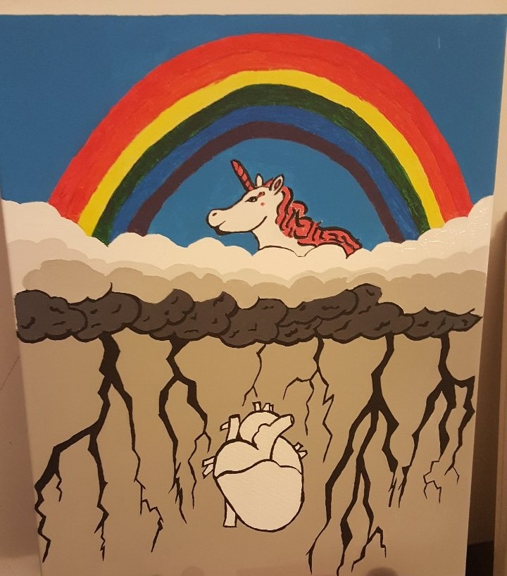 A painting by a Thresholds clients depicting Bipolar Disorder. The top half of the painting is a unicorn and a rainbow. Below it are stormclouds and a heart in black-and-white.