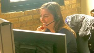 a thresholds staff person on the phone using a headset